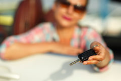 Woman sitting in a convertible car with the keys in hand - conce. Young pretty woman sitting in a convertible car with the keys in hand - concept of buying a Royalty Free Stock Photo