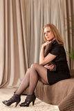 Woman sitting on the couch Royalty Free Stock Image