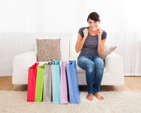 Woman Sitting On Couch Stock Photography
