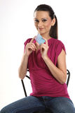 Woman sitting with credit card. Woman sitting on chair with credit card Stock Photo