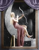 Woman sitting on crescent moon with bow and arrow stock images