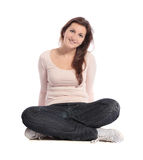 Woman sitting cross-legged. Attractive young woman sitting cross-legged. All isolated on white background Royalty Free Stock Photography