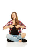 Woman sitting cross-legged Royalty Free Stock Images