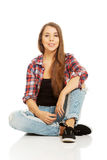 Woman sitting cross-legged Royalty Free Stock Photo