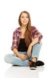 Woman sitting cross-legged Royalty Free Stock Photo
