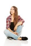 Woman sitting cross-legged Stock Image
