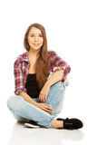 Woman sitting cross-legged Royalty Free Stock Image