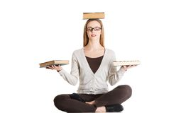Woman sitting cross-legged holding book on head Royalty Free Stock Photo