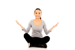 Woman sitting cross legged with open hands. Royalty Free Stock Photo