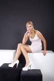 Woman sitting on cube Stock Photo