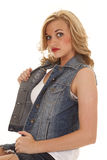 Woman sitting in denim jacket serious Stock Photography