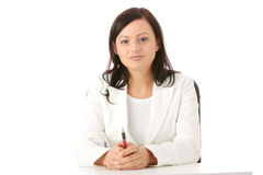 Woman sitting at the desk Stock Photos