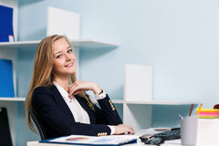 Woman sitting at the desk  with computer Stock Image