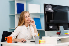 Woman sitting at the desk  with computer Royalty Free Stock Photo