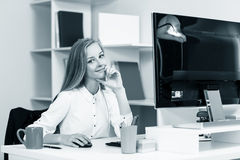 Woman sitting at the desk  with computer Stock Photo