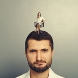 Woman sitting on the displeased man Royalty Free Stock Photos
