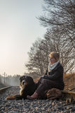 Woman sitting with dog Royalty Free Stock Photos
