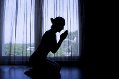 Woman Sitting Down In Prayer Silhouette Royalty Free Stock Photography