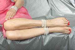 Woman sitting down wearing pearls Stock Images