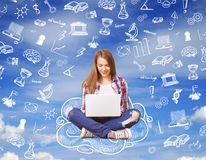 Woman sitting on drawing cloud. Young woman sitting on drawing cloud and using laptop, education concept Royalty Free Stock Photography