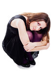 Woman sitting in dress and violet pantyhose Stock Photography