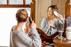 Woman sitting at the dressing table during the winter Royalty Free Stock Photo
