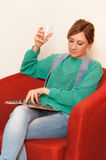 Woman Sitting, Drinking and Reading Stock Image