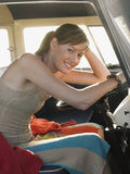 Woman Sitting At Driver's Seat Of Campervan Royalty Free Stock Photography