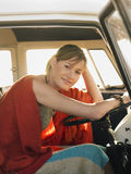 Woman Sitting At Driver's Seat Of Campervan Royalty Free Stock Image