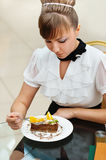 Woman sitting eating cake Royalty Free Stock Image