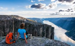 A woman is sitting on the edge of cliff on the way to boulder K royalty free stock photos