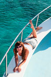 Woman sitting on edge of yacht royalty free stock photo