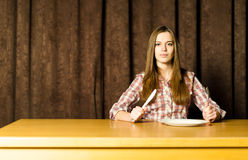 Woman Sitting at Empty Table Stock Image