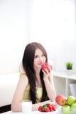 Woman sitting enjoing Apple Stock Image
