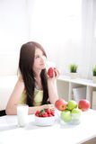 Woman sitting enjoing Apple Royalty Free Stock Photography