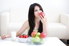 Woman sitting enjoing Apple Royalty Free Stock Photos