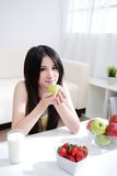 Woman sitting enjoing milk and fruits Royalty Free Stock Photos