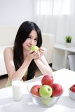 Woman sitting enjoing milk and fruits Stock Photo