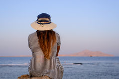 Woman sitting enjoying a tranquil sunset Royalty Free Stock Photography