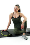 Woman sitting on an exercise mat. Image of a hot female sitting on an fitness mat Stock Photos