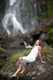 Woman Sitting by Falls Stock Image