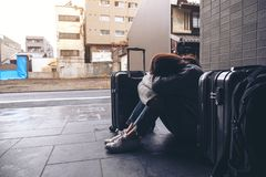 A woman sitting with feeling sad and cry while traveling royalty free stock photo