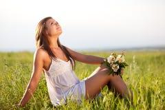 Woman sitting on field Stock Image