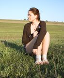 Woman sitting in a field Royalty Free Stock Photography