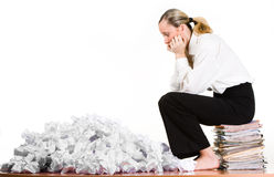 Woman sitting on files Royalty Free Stock Image