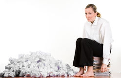 Woman sitting on files Royalty Free Stock Photos