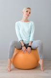 Woman sitting on the fitball Stock Image