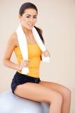 Woman sitting on fitness ball Stock Photo