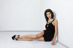 Woman sitting on floor Royalty Free Stock Image