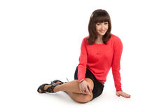 Woman sitting on a floor Stock Photography